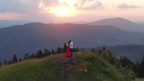 Couple in love embrace and enjoy intimate moment together sky background Footage