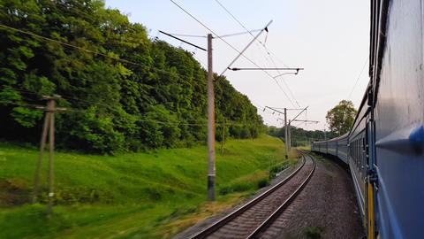 The view from the high-speed train on the beautiful scenery with hills and Footage