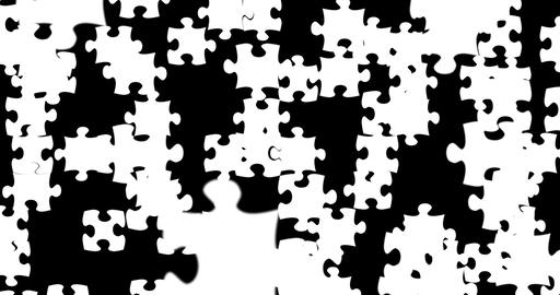 many puzzle pieces with color white falling down on black screen background, abstract motion Footage