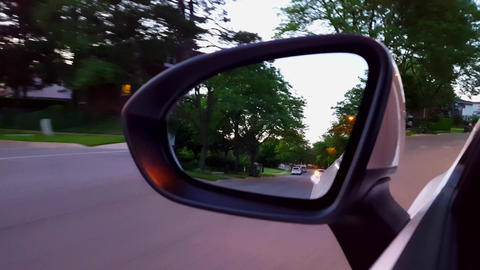 Driving Residential Road View of Side Mirror. Driver Point of View POV of Side View Mirror Along Live Action