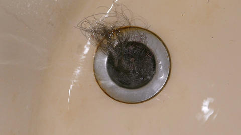 Water pouring into clogged bath plug hole Footage