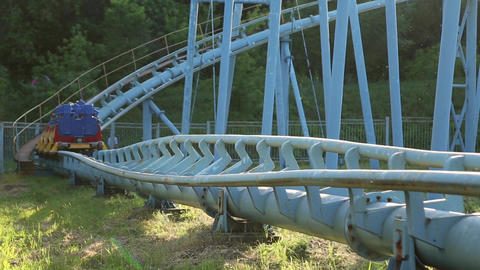 Rollercoaster train is moving along the track Footage