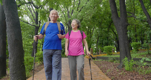 Happy asian Senior Couple On Vacation Enjoying Their Hiking Footage