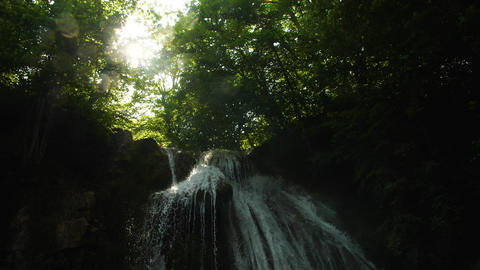 beautiful natural waterfall in the forest Live Action