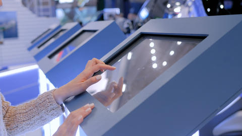 Woman using interactive touchscreen display at modern museum Footage