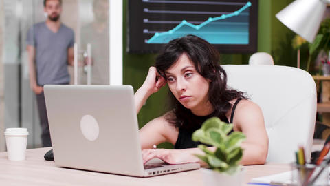 In busy office woman yawns while working on the computer Live Action