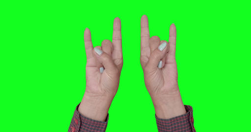 Hands in the form of horns at a rock concert in front Footage