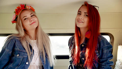 a pair of young women in the style of boho are smiling and satisfied Footage