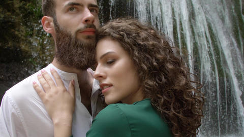 couple of lovers young woman and man with a beard hugging against the background Footage