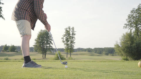 Unrecognized man playing golf on the golf course. The concept of recreation and Live Action