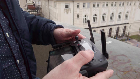 Drone Remote Controller / Hand and remote view of a drone pilot operator Live Action