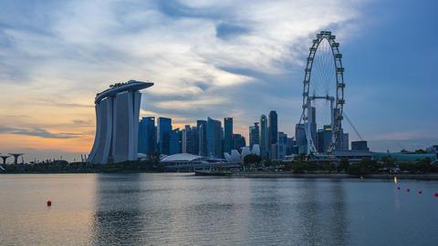 Singapore city skyline with view of Singapore landmark buildings day to night time lapse Footage