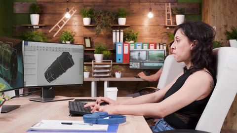 Female CAD designer drinks cofee while working in professinoal 3D software Footage