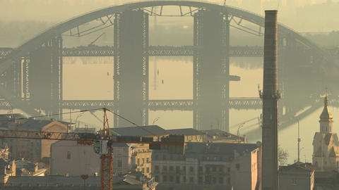 Darnystkyibriedge bridge with cityscape in Kiev, Ukraine during misty morning Footage