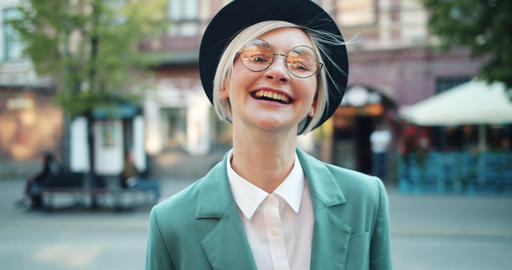 Slow motion of joyful young woman laughing outdoors in city having fun Footage