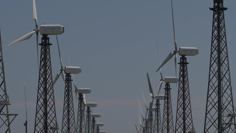slow motion rows of wind turbines that work Footage