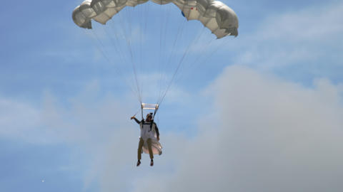 Wingsuite skydiver on parachute Live Action