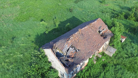 Flight above the old abandoned and ruined house and beautiful summer landscape Footage