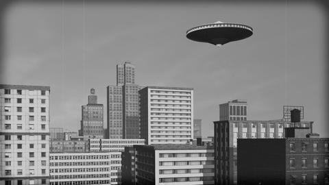 Vintage Alien Invasion: UFO over downtown. Black and white Animation Animation