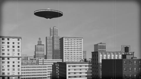 Vintage Alien Invasion: UFO over downtown. Black and... Stock Video Footage