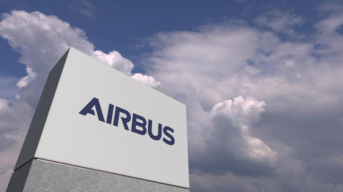 Logo of AIRBUS on a stand against cloudy sky, editorial 3D animation Live Action
