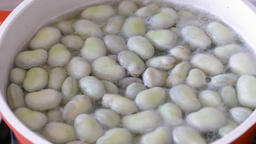 Cooking fava beans in water with salt. Fava beans also caled broad beans Live Action