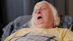 Senior lady is sleeping in a recliner Footage