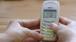Man is using still working vintage Nokia 3410 mobile phone Footage