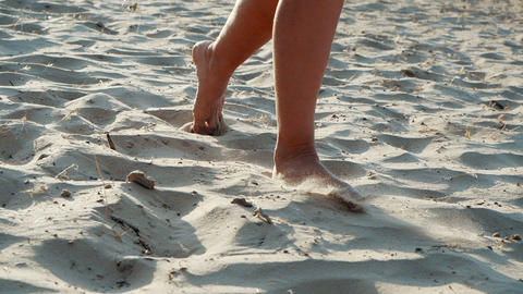 Active sporty barefoot woman runs on a sand beach in SLOW MOTION. Woman fitness Footage