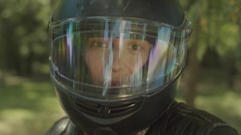 Portrait of attractive woman in motorbike helmet Live Action