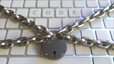 Padlock and chains on the keyboard with CODE text. Conceptual 3D animation Footage