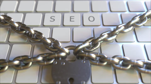 SEO word on the keyboard with padlock and chains. Conceptual 3D animation Footage