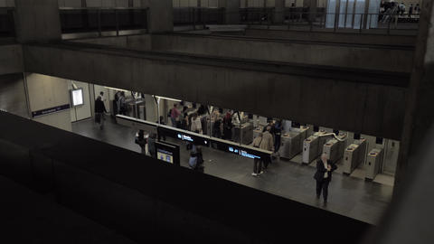 A top view of people walking through automatic turnstiles Live Action