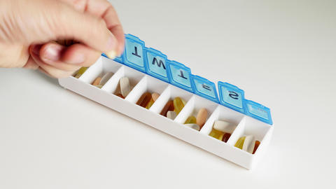 Adding Vitamins to a pill organizer Live Action