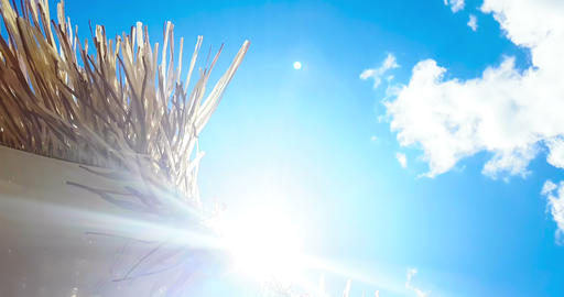straw beach umbrella under blue sky, slow motion movement on wind, summer holiday Footage