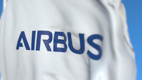 Flag with Airbus SE logo, close-up. Editorial 3D rendering Live Action