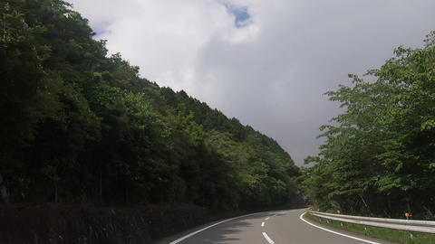 Driving image running under the sky covered with clouds Footage
