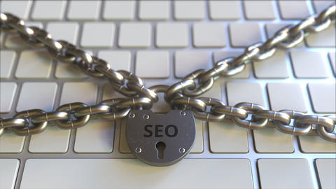 Chains and padlock with SEO text on the computer keyboard. Conceptual 3D Live Action