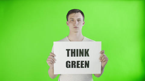 Young Man Activist With Think Green Poster on chroma key background Live Action