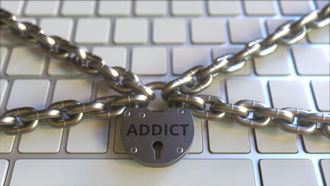 Chains and padlock with ADDICT text on the computer keyboard. Conceptual 3D Live Action