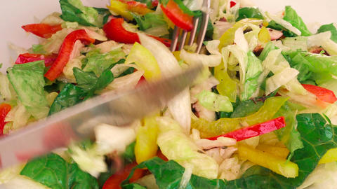 Closeup POV shot of a Foodie Stirring a Delicious Octopus Salad 영상물