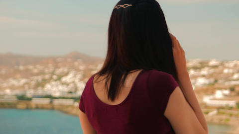 Lady Chatting on the Cell Phone in a Mediterranean Island Footage
