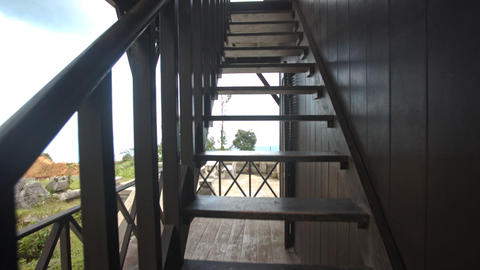 Camera Moves Upstairs from Terrace to Balcony of Yersin House Footage