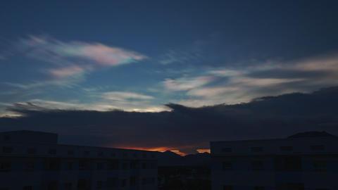 Orange Sunset in Dark Blue Cloudy Sky above City Buildings Footage