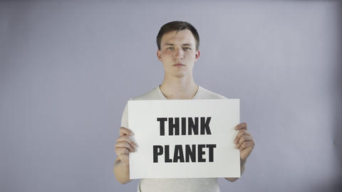 Young Man Activist With Think Planet Poster on grey background Live Action
