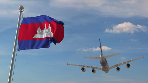 Airliner passing above national flag of Cambodia. Cambodian air transportation Live Action