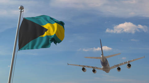 Airplane flying over flag of Bahamas. Bahamian tourism related 3D animation Live Action