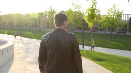 mature man walking in park / outdoors / positive emotion Footage