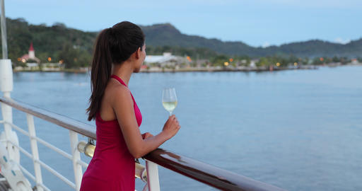 Cruise ship vacation woman relaxing in sun enjoying drinking a glass of wine Footage