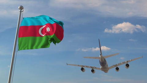 Commercial airplane flying over national flag of Azerbaijan. Azerbaijani air Live Action
